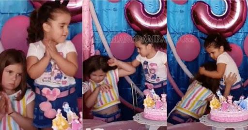 Hai chị em tranh giành thổi nến sinh nhật
